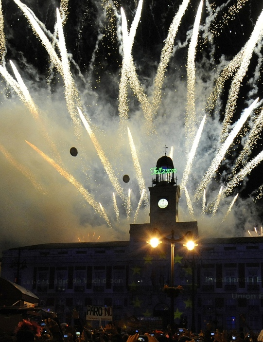 Fireworks explode over the Puerta del So